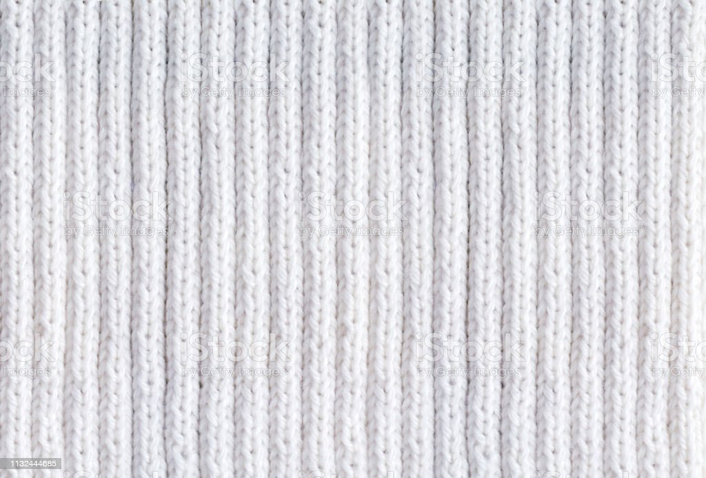 Sweater or scarf texture large knitting. Knitted jersey background...