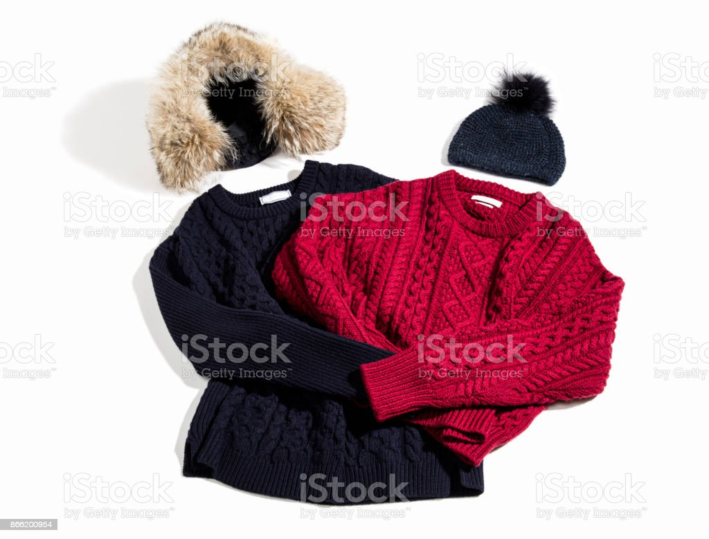 Sweaters and knitting hats isolated on white background stock photo