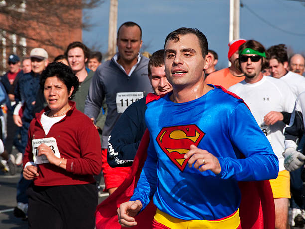 Sweating Superman Costume Runner in Thanksgiving Day Connecticut Road Race stock photo