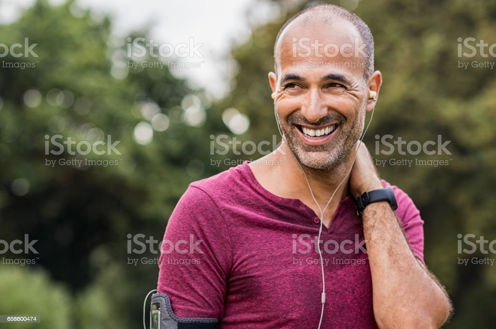 Sweaty man resting after exercise stock photo