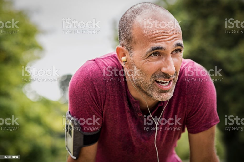 Sweaty mature jogger stock photo