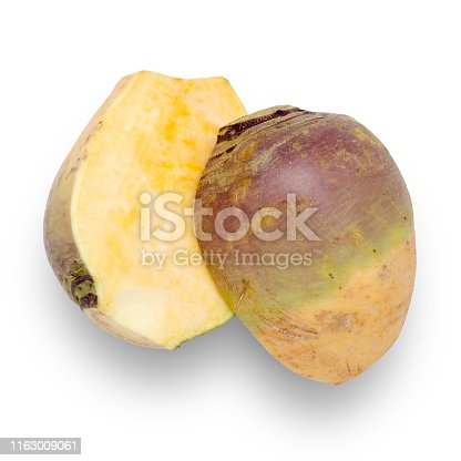 Swede vegetable cut in half isolated on white with clipping path