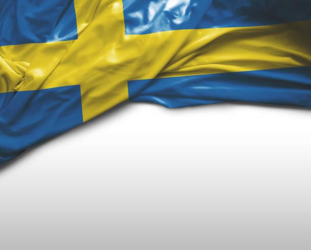 Acenando a bandeira da Suécia - foto de acervo