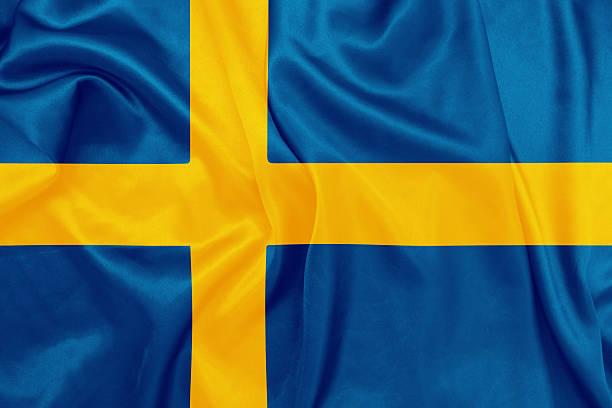 Suécia-acenando a bandeira nacional de textura de seda - foto de acervo