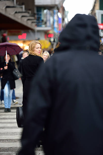 swedish blonde woman, followed? - stalking stock photos and pictures