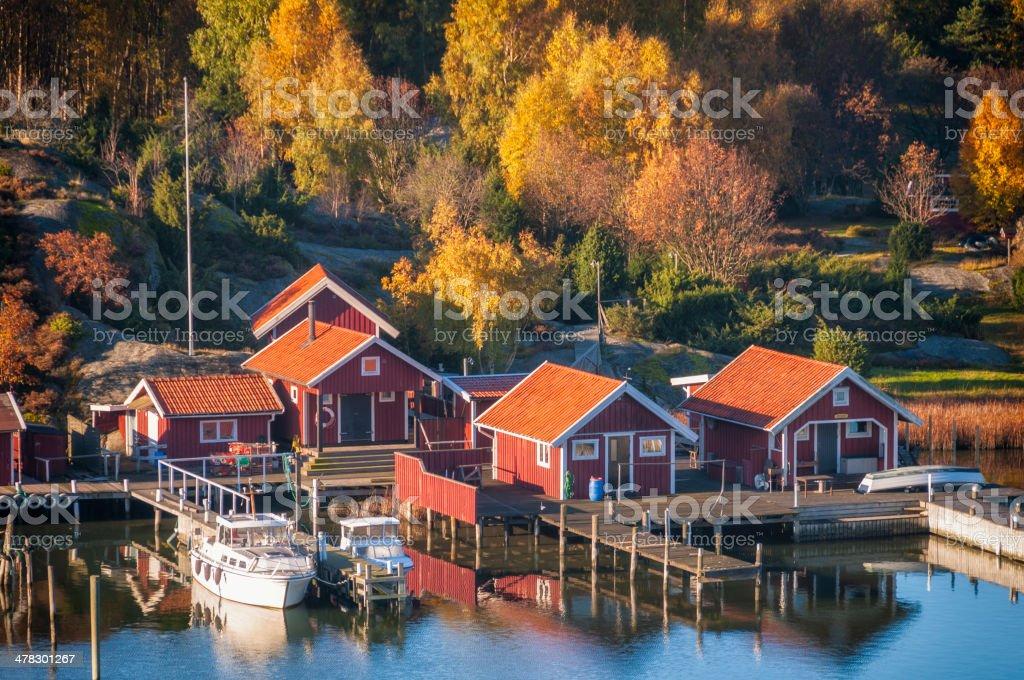 Swedish boathouses in hazy morning light royalty-free stock photo