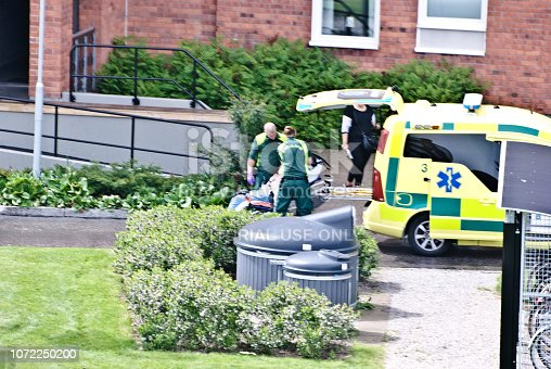 istock Swedish first responders attend to the sick outside a residential building in Nacksta - Sundsvall, sweden 1072250200