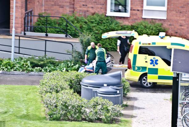 swedish first responders attend to the sick outside a residential building in nacksta - sundsvall, sweden - first responders zdjęcia i obrazy z banku zdjęć