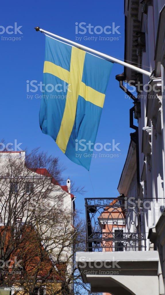 Swedish Flag Hanging Above Balcony stock photo