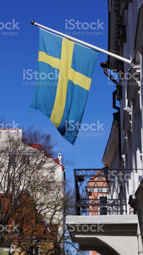Swedish flag on flagpole stock photo