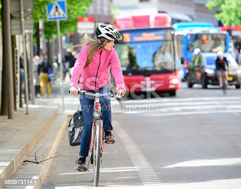istock Swedish girl and bicycle in traffic 583973114
