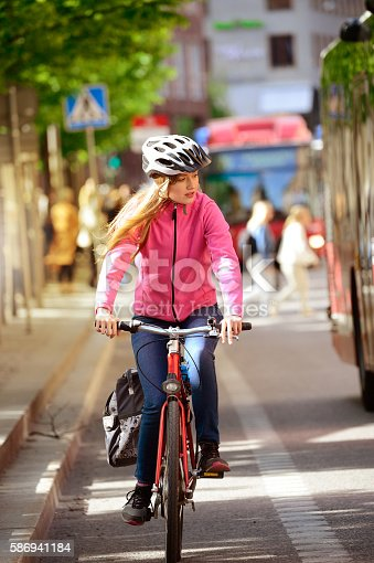 istock Swedish girl and bicycle in traffic 586941184