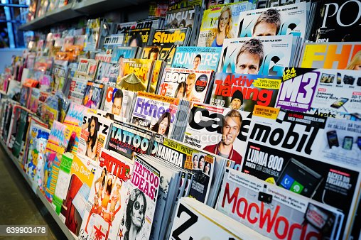 News stand. Mixed magazines and papers.