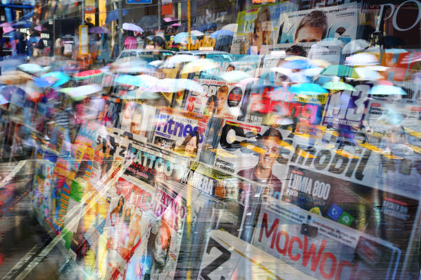 Swedish news stand, mixed magazines, umbrellas reflected in window News stand. Mixed magazines and papers. news stand stock pictures, royalty-free photos & images
