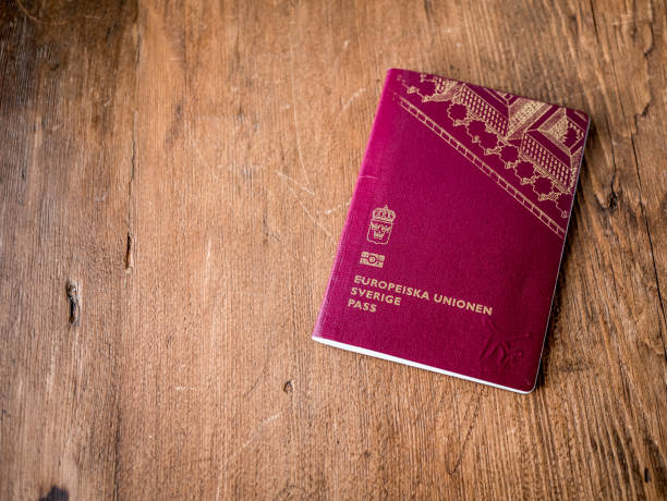 Swedish passport folded on wood rustic background. stock photo
