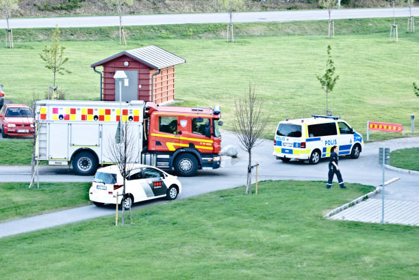 swedish security & first responders (incl. the fire service and the police) attend to an emergency in a residential building in nacksta, sundsvall (north of stockholm) - sweden. - first responders стоковые фото и изображения