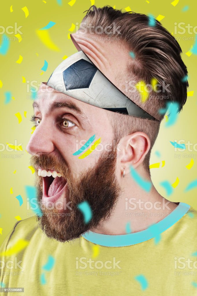 Swedish soccer fan with football inside the head stock photo