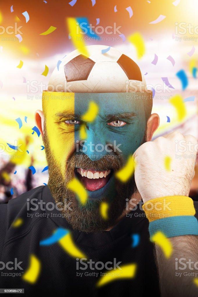 Swedish soccer fan with football inside the head - foto stock
