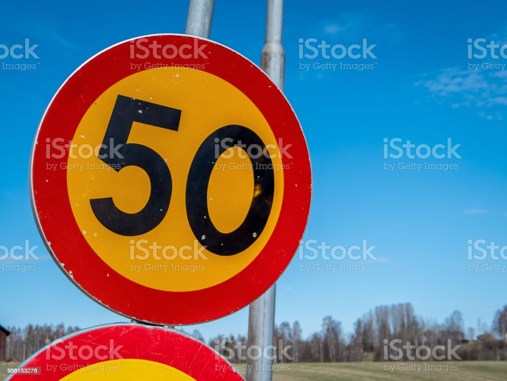 Swedish speed sign of 50 km/h. Swedish speed sign of 50 km/h. Blue Stock Photo