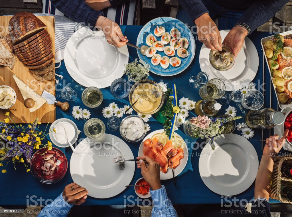 Swedish summer Midsommar Midsummer celebration dinner party stock photo