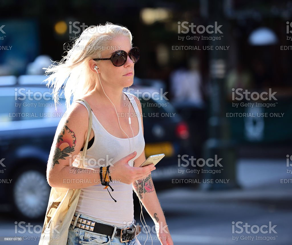 Swedish woman with headphones stock photo
