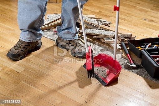 istock Sweeping Floor into Dustpan 473158422