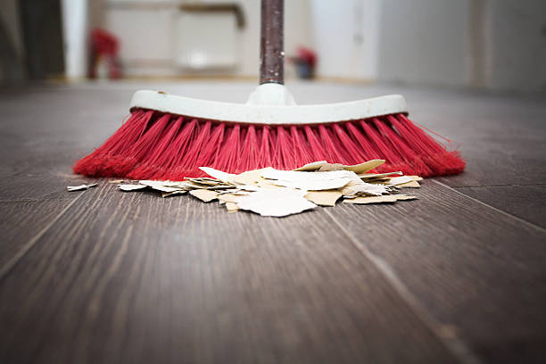 sweeping floor with broom - sweeping stock pictures, royalty-free photos & images