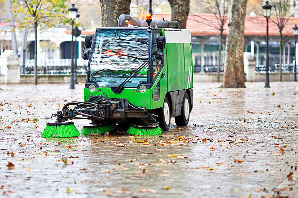 sweeping machine sweeping machine picking the leaves of the trees street sweeper stock pictures, royalty-free photos & images