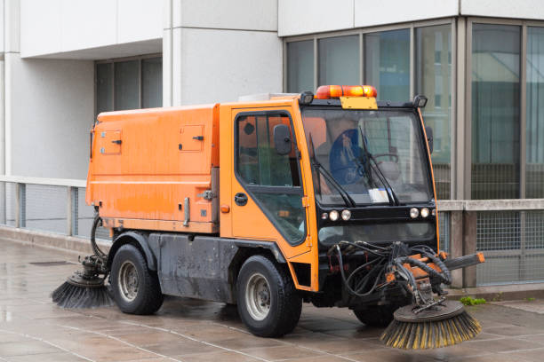 Sweeping machine The machine for cleaning streets in the city center street sweeper stock pictures, royalty-free photos & images