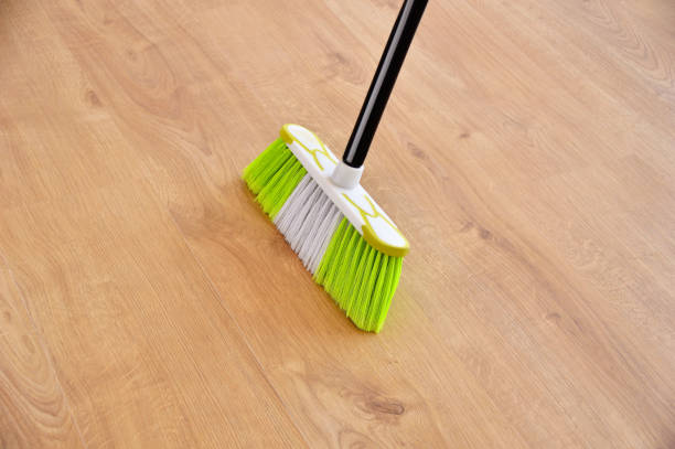 sweeping the parquet floor housework, cleaning and housekeeping concept - close up of  broom sweeping floor at home broom stock pictures, royalty-free photos & images