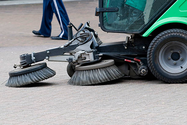 Sweeping the Streets Person driving a street cleaning machine. street sweeper stock pictures, royalty-free photos & images