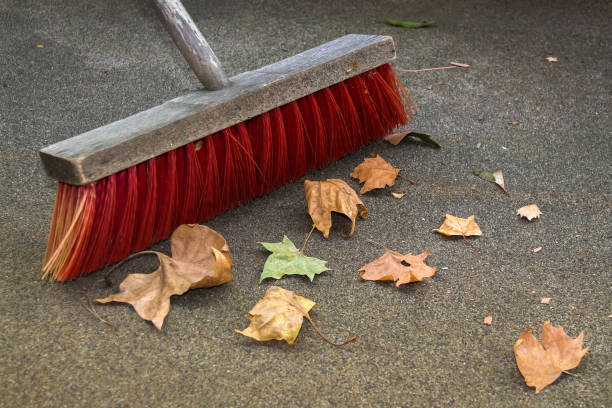 sweeping up the autumn leaves - sweeping stock pictures, royalty-free photos & images