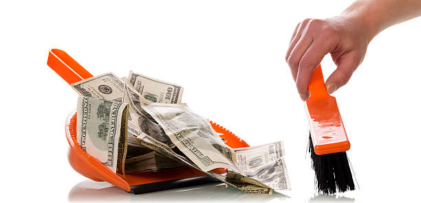 sweeps money in the scoop - throw money away stock pictures, royalty-free photos & images