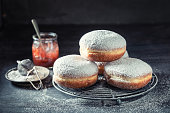 Sweet and brown donuts with red jam