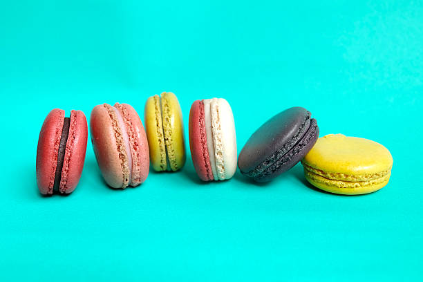 Sweet and colourful french macaroons on retro-vintage stock photo