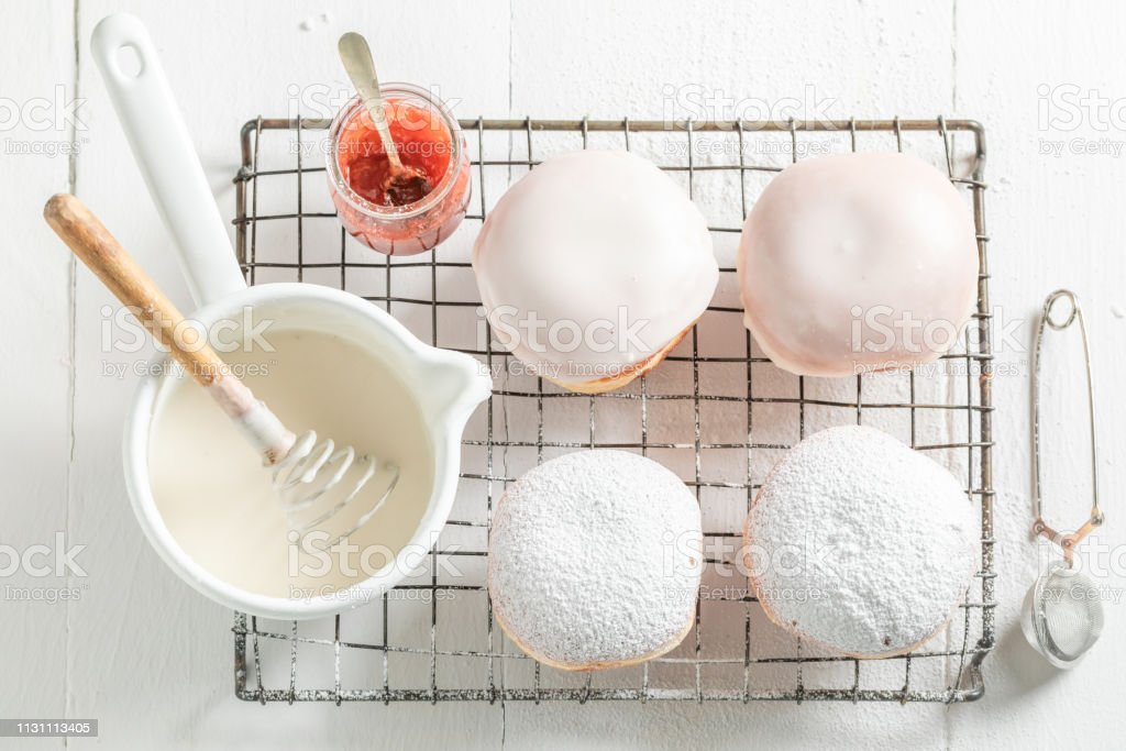 Sweet and fresh donuts on cooling grate