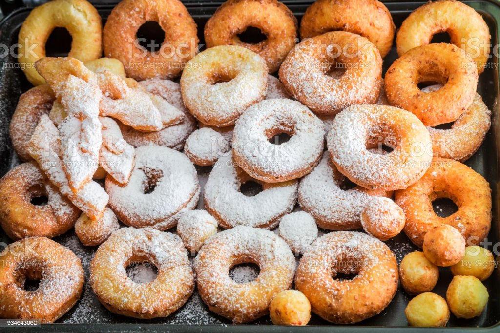 Sweet and homemade donuts with powdered sugar stock photo