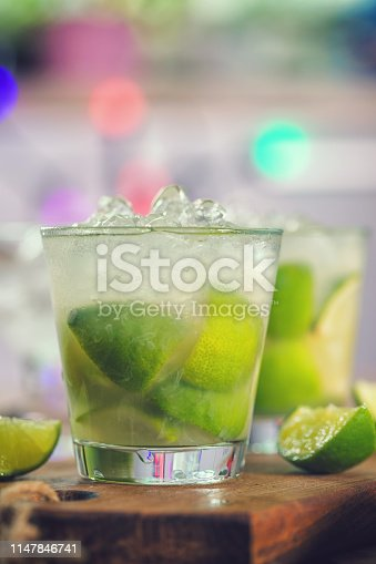 Sweet and refreshing Caipirinha national cocktail from Brazil made with lime,ice, sugar, and a sugarcane liquor