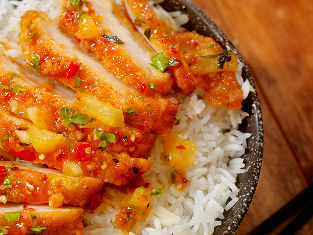 sweet and sour chicken with rice - chinese food stock photos and pictures