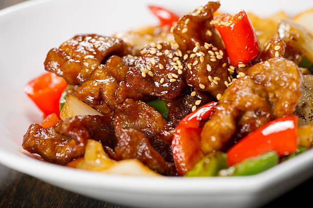 sweet and sour pork - chinese food stock photos and pictures