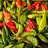 Sweet and spicy green and red chilli peppers for sale in the farm market. Many other fresh vegetables and other foods are sold in local markets around the world.