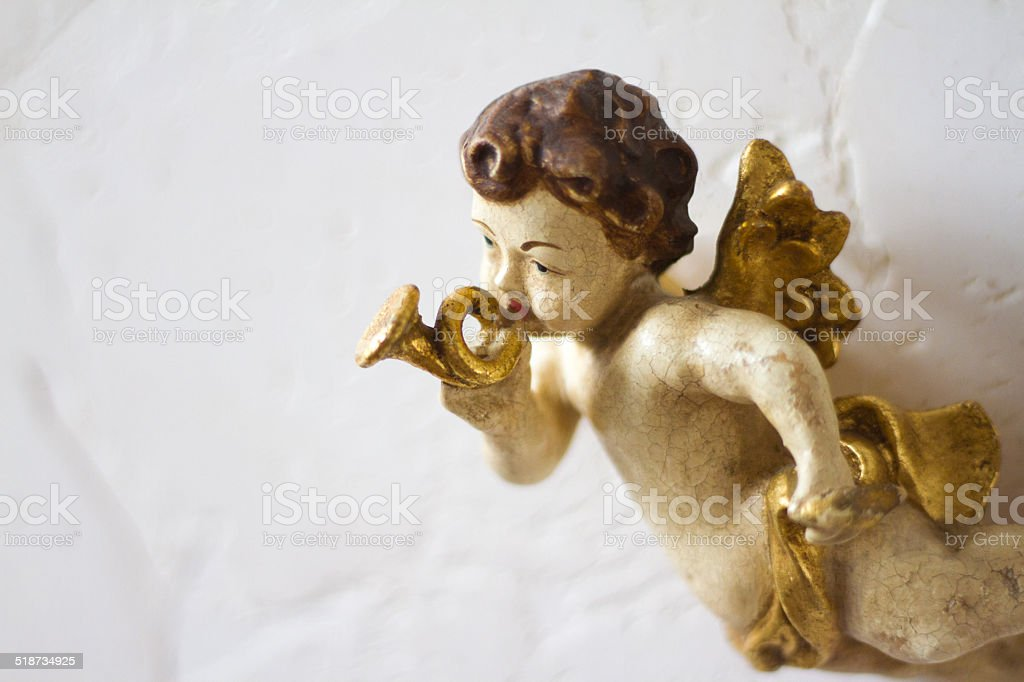 Sweet Antique Cherub With Gold Trumpet stock photo