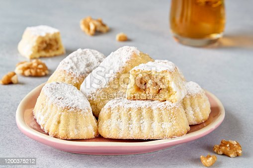 1200374148 istock photo Sweet arabic pastries stuffed with walnuts . Traditional maamoul cookies 1200375212