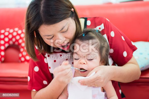 istock sweet Asian baby ready for her dinner 855363550