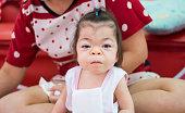 sweet Asian baby ready for her dinner