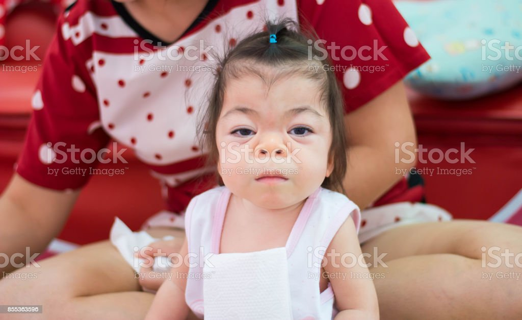 sweet Asian baby ready for her dinner stock photo