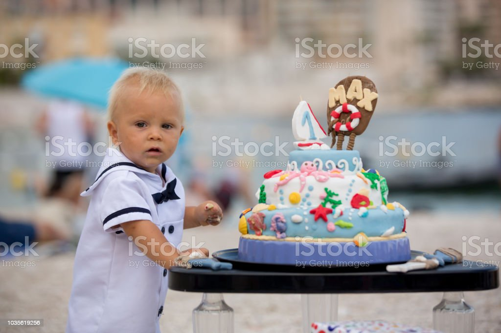 Sweet Baby Boy Celebrating First Birthday With Sea Theme Cake And