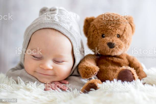 Sweet baby boy in bear overall sleeping in bed with teddy bear picture id907211532?b=1&k=6&m=907211532&s=612x612&h=jxnr7mnn l7g3zycgnpknmiqyizkwawfqgtkx7lf63k=