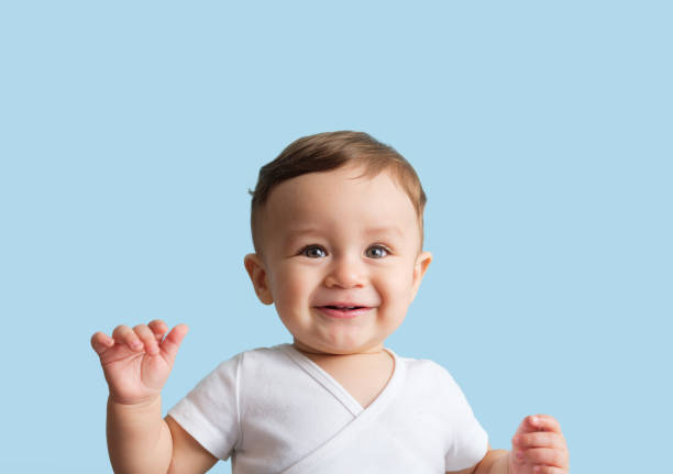 Sweet baby boy smiling stock photo