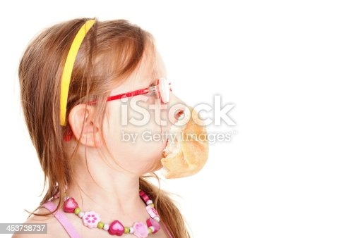 istock sweet baby girl eating bread 453738737